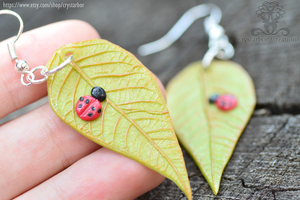 Leaf clay earrings with ladybug  Handmade by Crystarbor