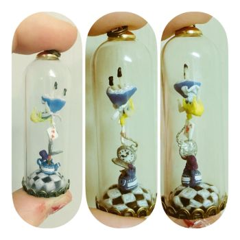Alice in wonderland pendant by Blindfaith-boo