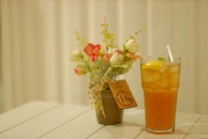 a glass of ice lemon tea by crything