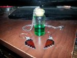 Green potion and half heart ear rings by Blind-Kidd