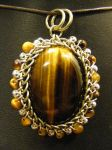 orbit tigers eye pendant by BacktoEarthCreations