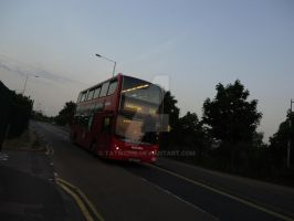 Bus on sunset light by Tatmione