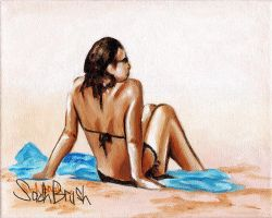 woman sitting on blue towel by sachbrush