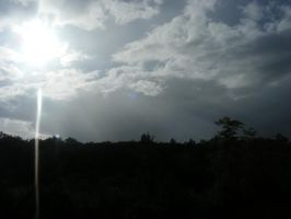 sun with storm clouds by BlueIvyViolet