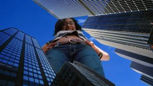 Liz towers over the city by lookagenericaccount