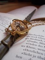Wand and Time Turner. by Felinaey