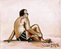 man relaxing on sand by sachbrush