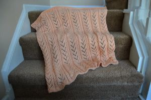 Peachy Arrows and cables Blanky by ivoryleopard