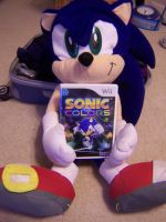 Sonic holding his game by KotoTheRabbit