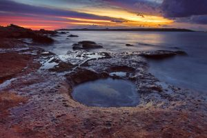Rockpool sunset by Kounelli1