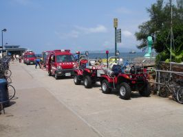 Fire trucks on parade by asiaseen