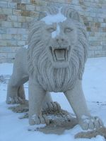 Stone Lion Statue in the Snow by FantasyStock