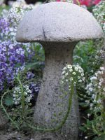 mushroom statue and flowers by bwall49