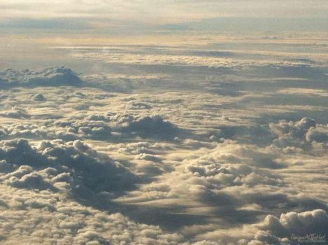 Clouds on a Plane. by Kyzzen