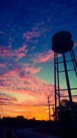 Sunrise over the water tower by ladybluejinx
