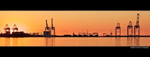 Industrial Sunset by Val-Faustino