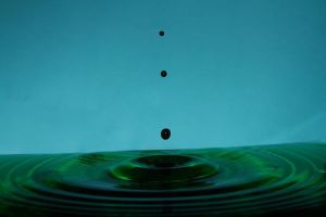 Green water droplets by Skulkarmy