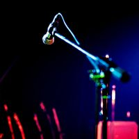 Behind the microphone by Frall