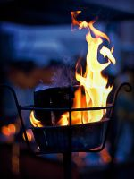 a warm fire on a cold day by schattenlosefotos