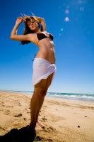 Stretching on the beach by JJImages