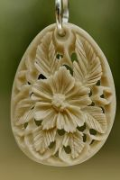 pendant 3 - bone carving by manuroartis
