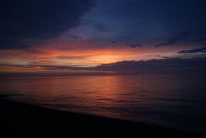The sunset in Pourville-sur-Mer by Amanita8V