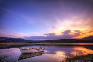 Boat on the river by Chris-Lamprianidis