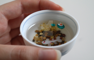 Miniature Koi in a Cup. by oceansinminiature