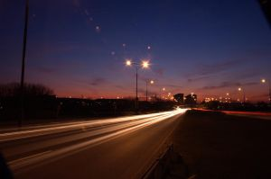 Sunset over highway by adamsik