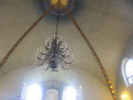 The candle chandelier of the Mantta road church by Lightningball