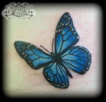 Blue butterfly by state-of-art-tattoo