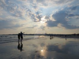 Second Beach with Man Pointing at the Sun by Charlief43