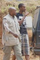 Ivan Kagame with a security official by linkexperts