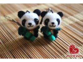 Pandas eating Bamboo by TheHeartofJapan