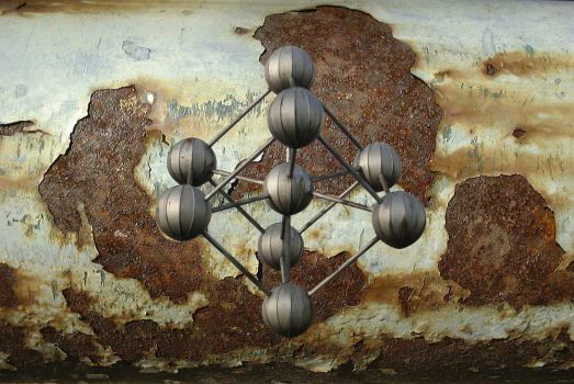 Rusty Atom Wall by GrAdThrawn