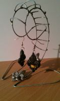 Handmade Baroque fleur de lis earrings by Sascomando