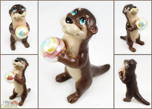 Otter Pup with Marble by LeiliaClay