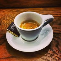 Double Espresso and a piece of chocolate by attomanen