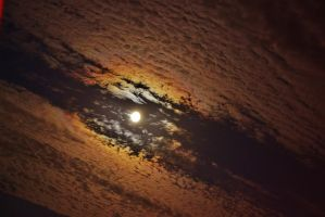 Moon Between Billowing Clouds by PsychodelicMess