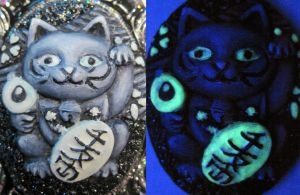 Glow in the dark Maneki Neko by slinkskull