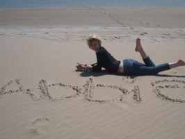 My name in the sand by Cupcake-Lakai