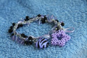 purple - black zebra braclet by NightSky1357