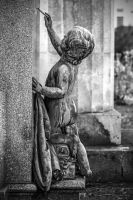 Naked child writing on a tombstone by attomanen