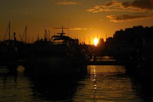 Sunset in harbour by Yenneferx