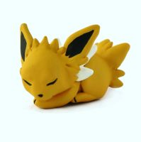 Sleeping Baby Jolteon Sculpture by LeiliaClay