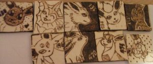 Eeveelutions Pyrography Pendants by weisewoelfin