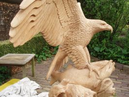 Woodcarver Eagle with salmon in progress 18 by woodcarve