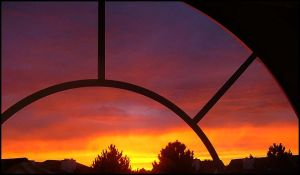 arched sunset by geekyartjunkie