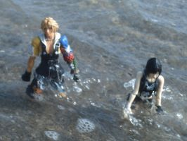 Yuffie and Tidus in the Waves by kingdomhearts800