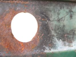 Rust Hole by Dom410
